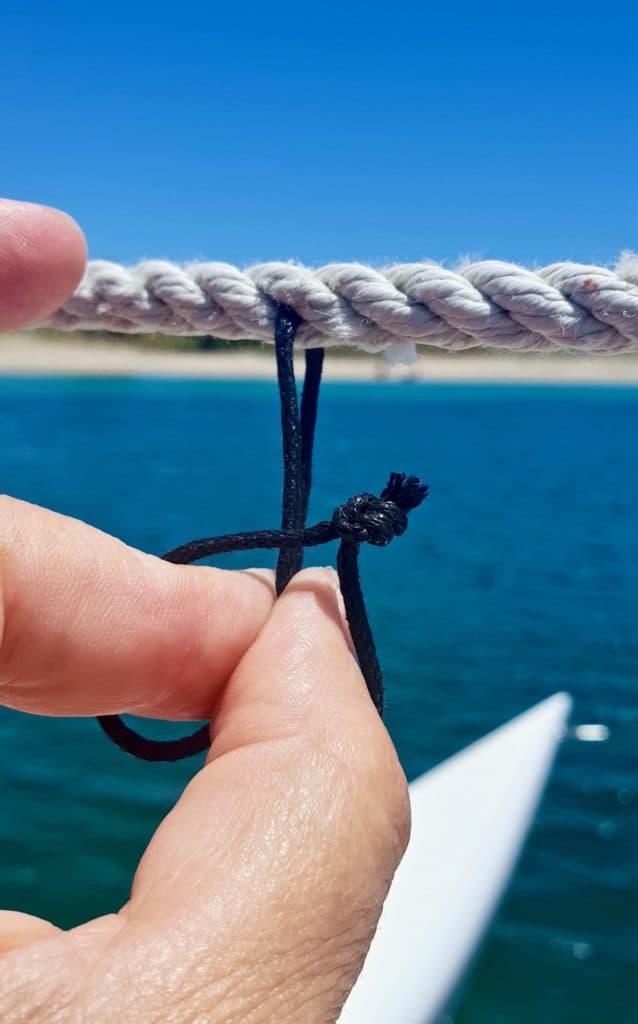 Make a loop of waxed cord.