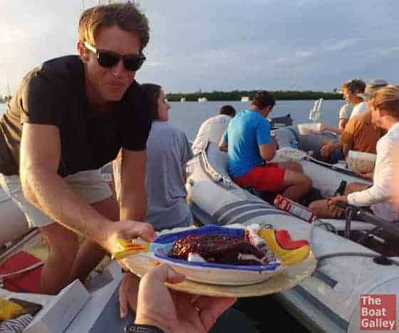 Passing food at a dinghy drift