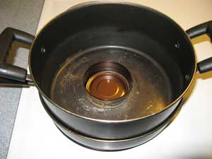 Picture of Dutch oven inside skillet with tuna can