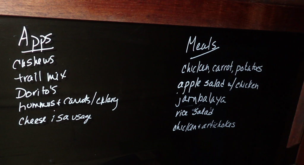 meal ideas on black plastic with white liquid chalk