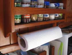 """The perfect paper towel holder for a boat, RV or anywhere a breeze can blow in through the window. Cheap, easy and solves paper towels """"blowing in the wind."""""""