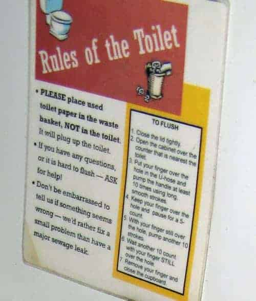 Sign over toilet on a boat